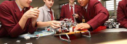 Students assemble robotic LEGO vehicles