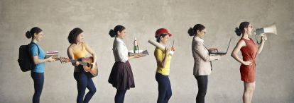 Students in a line, each personifying a different career, e.g. musician, waiter, construction worker